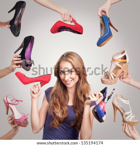 Portrait of beautiful young woman with shoes - stock photo