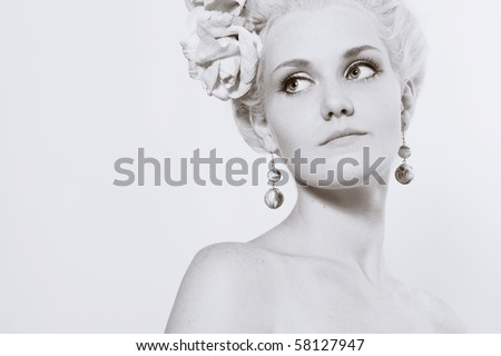 of beautiful young woman with stylish make-up and medieval hairstyle