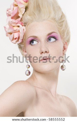 stock photo : Portrait of beautiful young woman with stylish make-up and medieval hairstyle