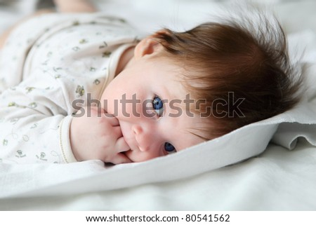 portrait of beautuful redhair infant with blue eyes