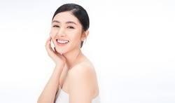 portrait of beauty asian woman with fair perfect healthy glow skin hand touching chin on white background, young beautiful asia girl with pretty smile face care. Beauty korean spa skincare.