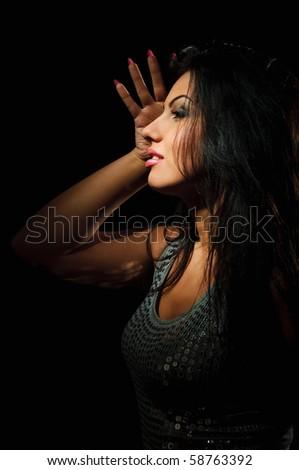 portrait of beauty brunette girl on black background