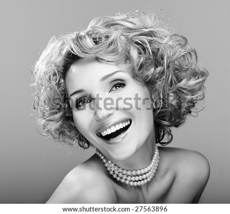Portrait of beauty laughing young woman - black and white image