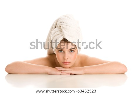 Portrait of beauty woman with head wrapped towel