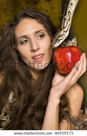 portrait of beauty young lady with snake and red apple