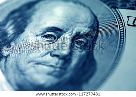 Portrait of Benjamin Franklin on a one hundred dollar banknote.