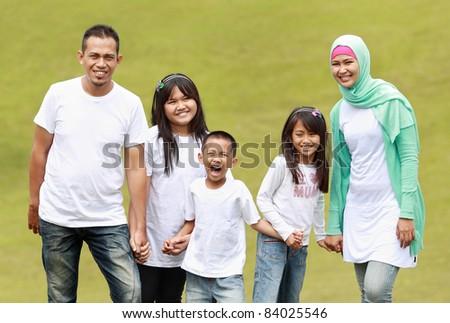 Portrait of big Family in the park having fun