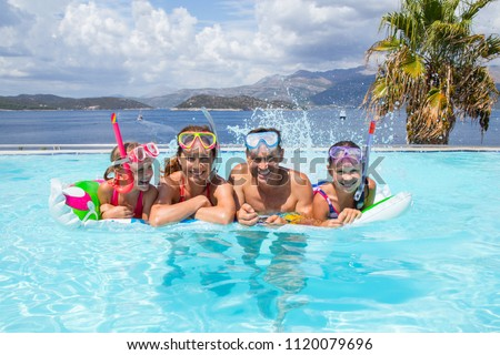 Portrait of big family  swimming in  pool on sea resort