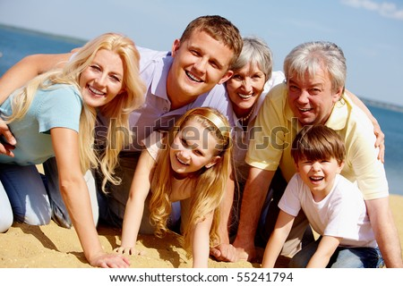 Portrait of big happy family looking at camera during vacation