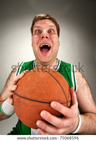 Portrait of bizarre basketball player with ball