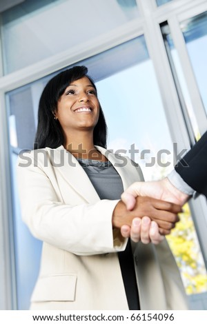 Portrait of black business woman shaking hands