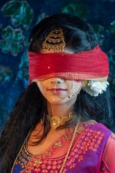 Portrait of black haired Indian brunette woman covering her eyes by a cloth,Concept of a great and noble character in Mahabharata.