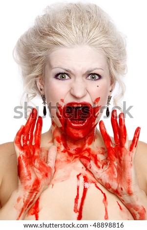 Portrait of blond bloody crying woman with old-fashioned hairstyle