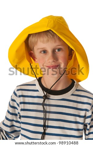 Portrait of blond boy with yellow rubber rain hat - stock photo