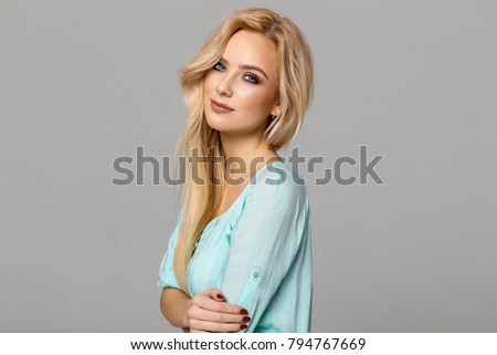 Portrait of blond female model with blue eyes