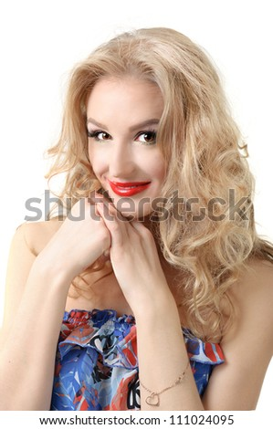 Portrait of blond long hair girl in colorful dress