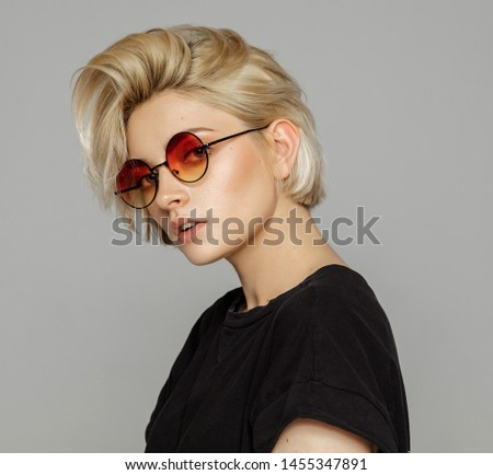 Portrait of blond woman in retro sunglasses