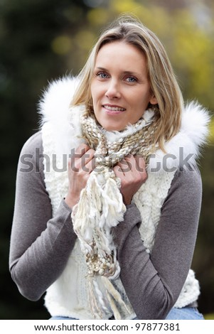 portrait of blond woman outdoor in autumn