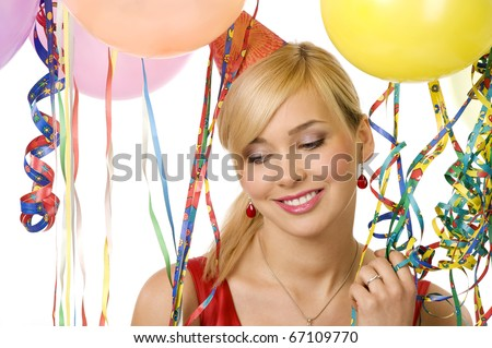 portrait of blond young woman between colored balloons and ribbons with a sweet smile - stock photo