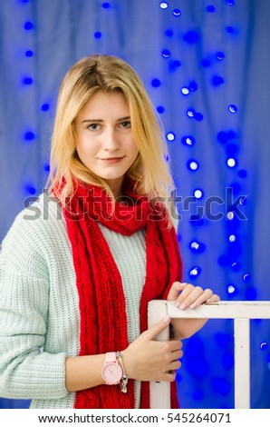 portrait of blond young woman between golden balloons. New Year concept.