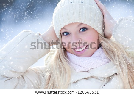 Portrait of blond young woman in winter - stock photo