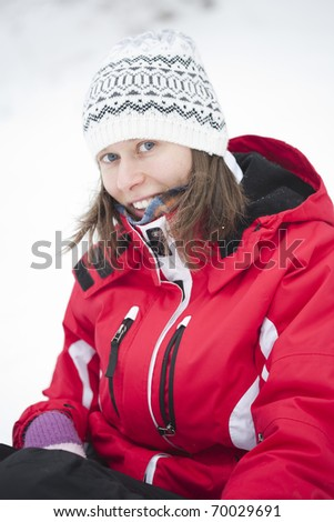portrait of blonde girl in the snow