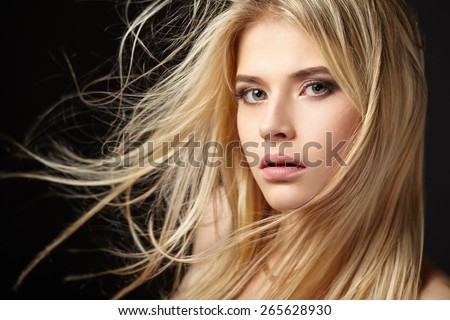 Stock Photo Portrait of blonde girl with fluttering hair