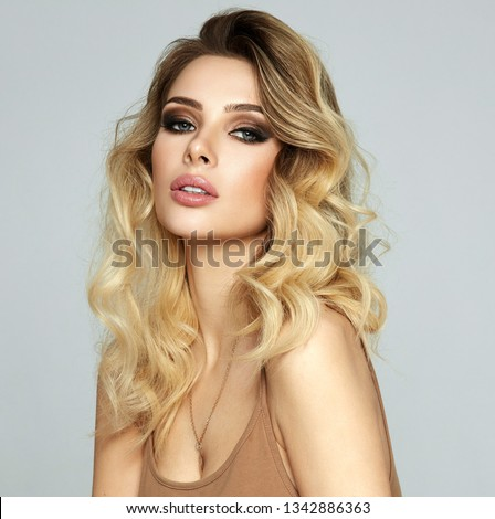Portrait of blonde sexy woman isolated on gray background #1342886363