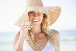 Portrait of blonde woman on the beach