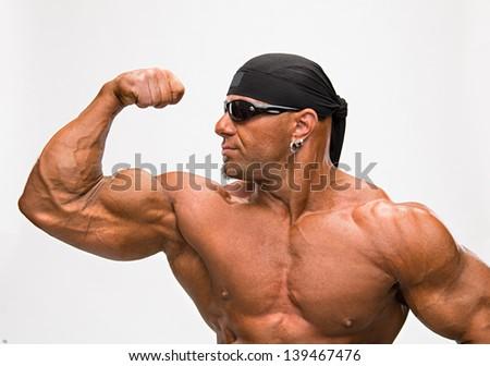 Portrait of bodybuilder on a white background