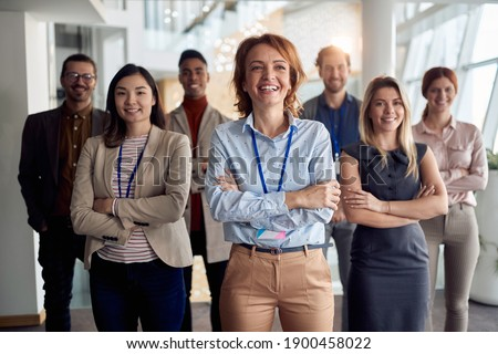portrait of bold and outgoing group of successful business people, looking at camera. eye contact
