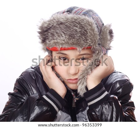 Portrait of bored boy with winter hat