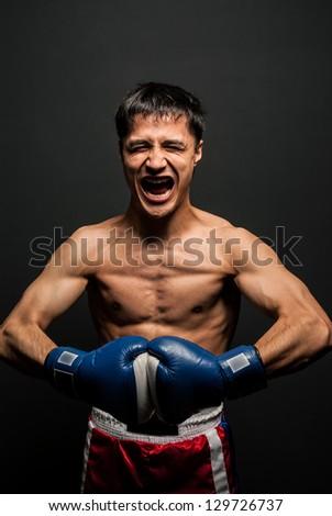 Portrait of  boxer in the dark screaming