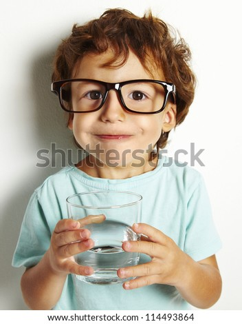 Portrait of boy drinking glass of water isolated in white