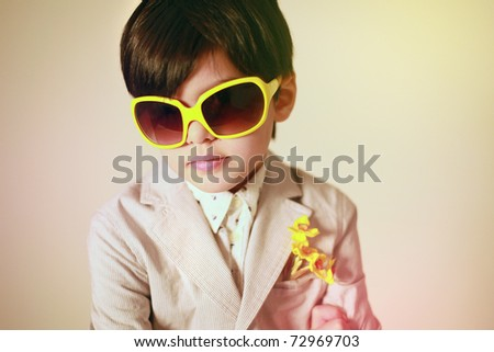 Portrait of boy in yellow  glasses. Retro style - stock photo