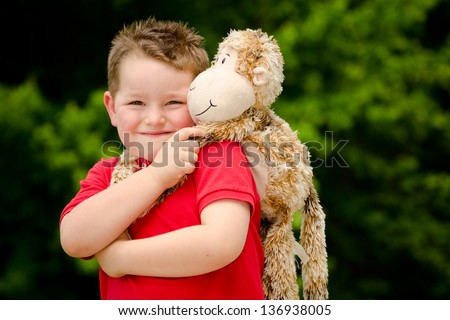 Portrait of boy playing with his stuffed animal pet