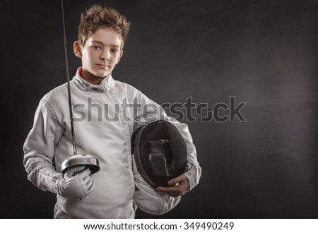 Portrait of boy wearing white fencing costume and black fencing mask