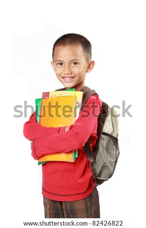 Portrait of boy with backpack smiling against white background