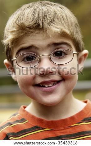 portrait of boy with eyeglasses