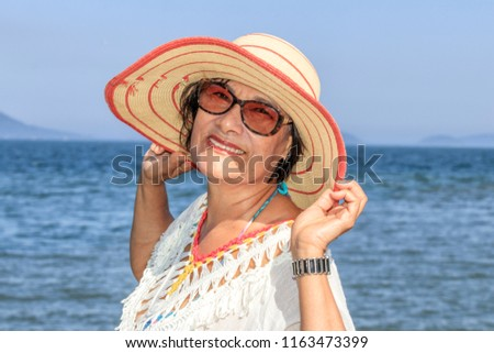 portrait of brazilian senior woman on beach
