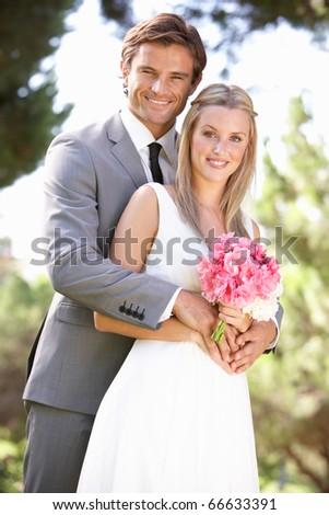 Portrait Of Bridal Couple Outdoors