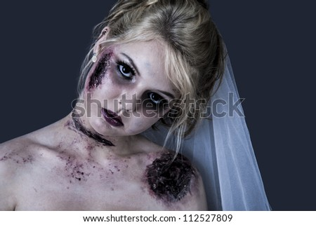 Portrait of bridal zombie with wound and stare creepy