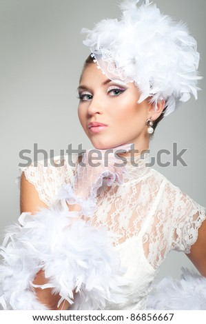Portrait of bride with beauty make-up and hat - stock photo