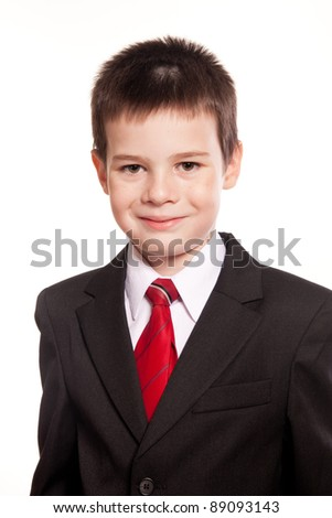 Portrait of business code kid in a suit and red tie posing in studio on white