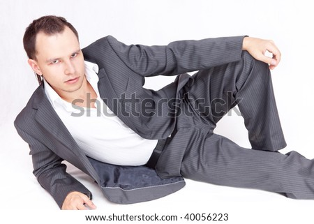 Portrait of business male model lays. Relaxing.