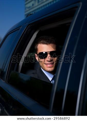 Portrait of business man inside the car
