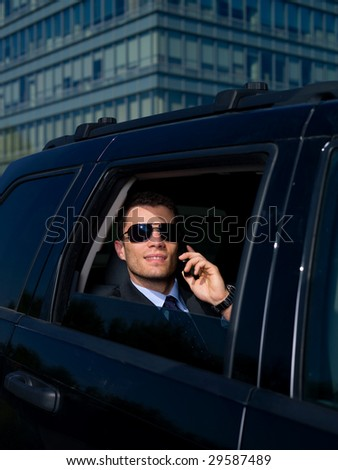 Portrait of business man inside the car - stock photo