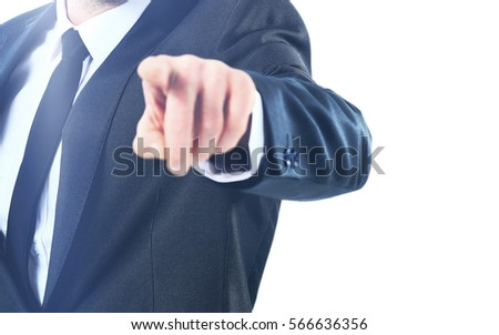 Portrait of business man pointing at you against white background