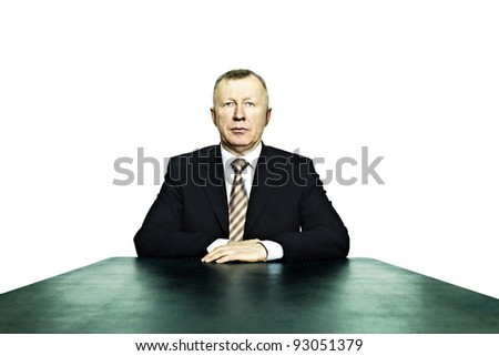 Portrait of business man sitting at the head of the table