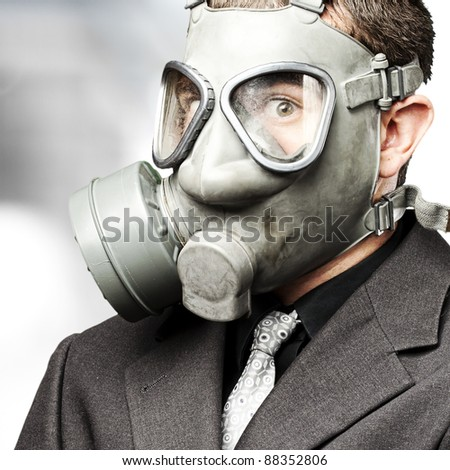 portrait of business man with gas mask indoor